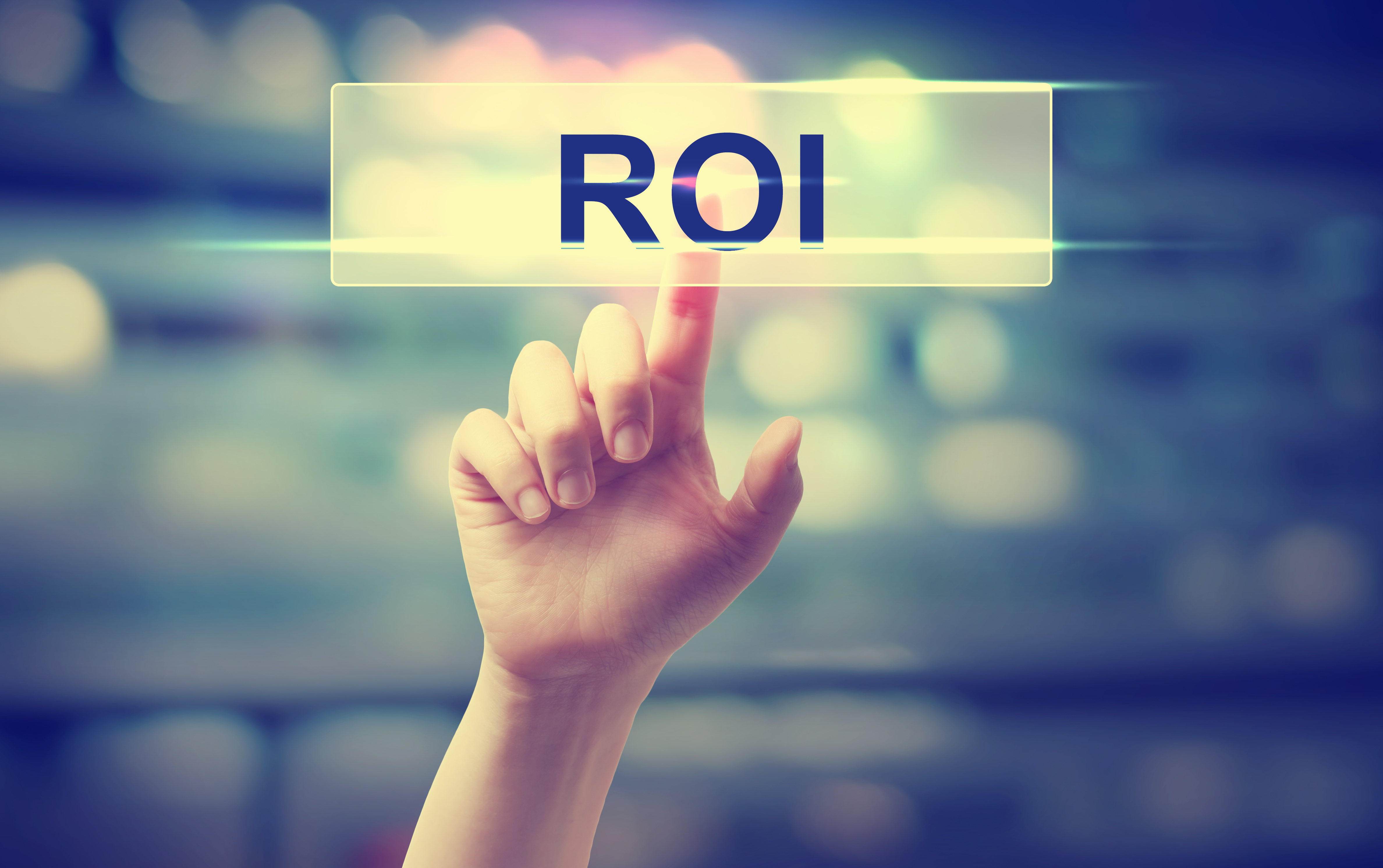ROI concept with hand pressing a button on blurred abstract background